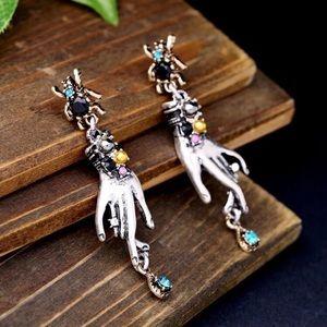 NWOT Creative spider earrings